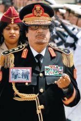 Каддафи впервые прибыл с офици ...